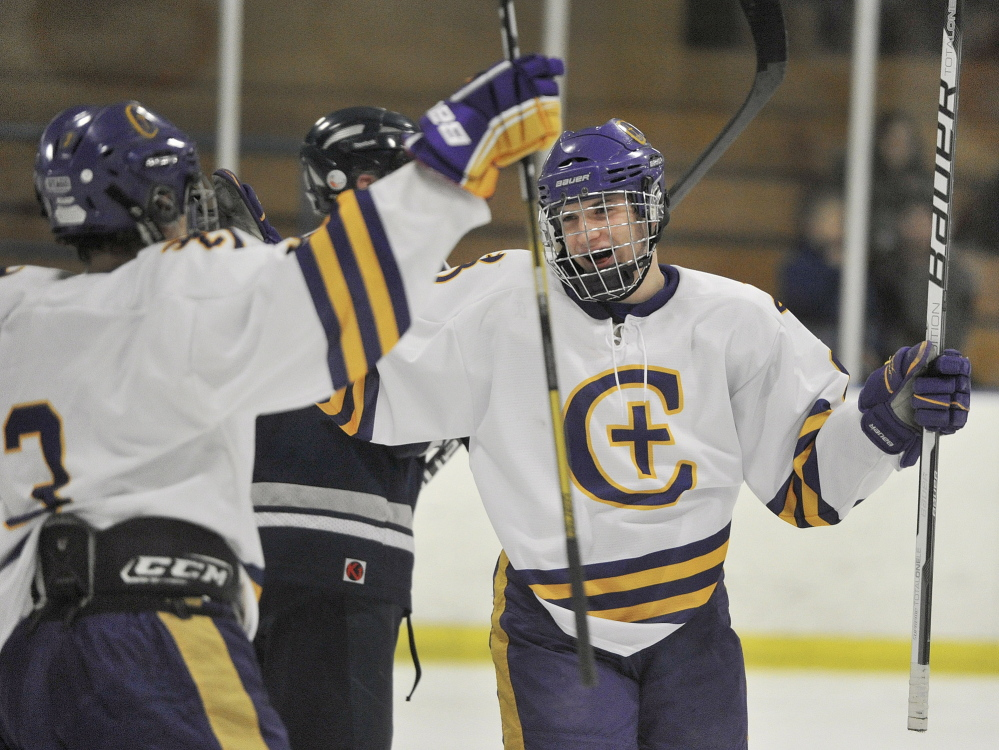 Nick Noyes of Cheverus, right, celebrates a goal in the second period. Noyes finished with a goal and two assists in helping the Stags improve to 6-2-1. Yarmouth is 4-3-1.