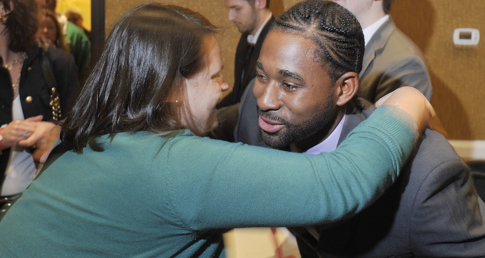 Jackie Bradley Jr., right, was welcomed by Portland fans Friday night at the Sea Dogs' annual dinner in South Portland. Bradley will compete for a Boston starting job.