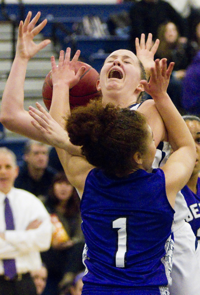 Brianna Holdren of Portland loses the ball Friday night while driving against Tasia Titherington of Deering. Holdren scored the key points in the final moments of a 60-55 victory at the Expo.