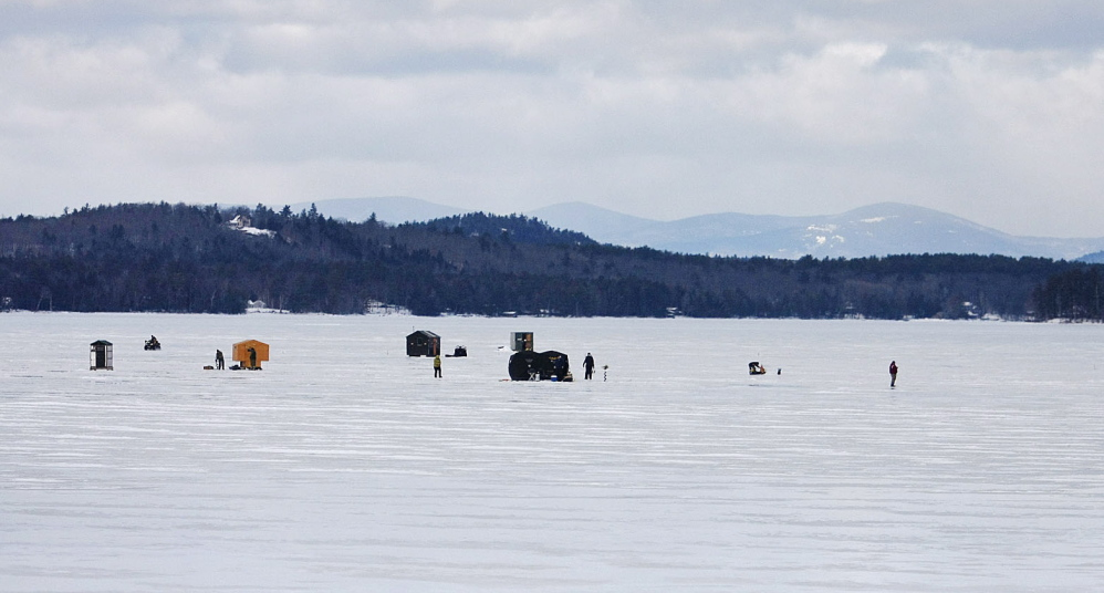 The shacks are in place and the anglers patiently waiting for something to take their bait as they fish Long Lake on a picture-perfect mid-January day.