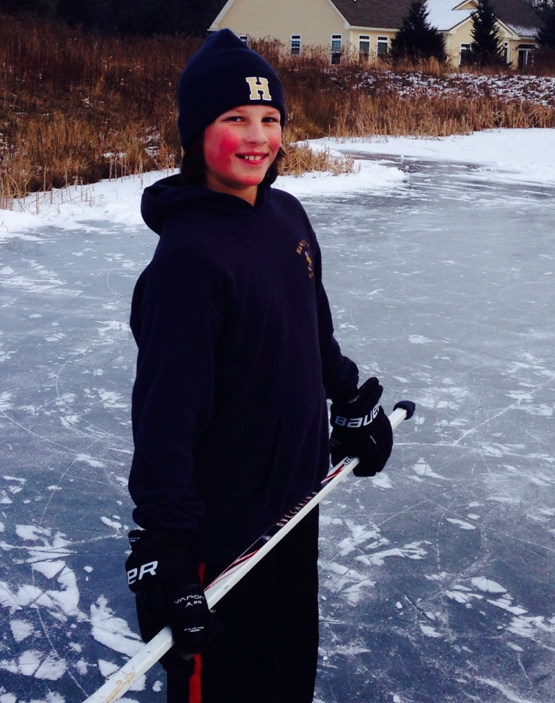 Matt Cox, 10, plays hockey outside his home before Christmas. He suffered a severe brain injury Dec. 26.