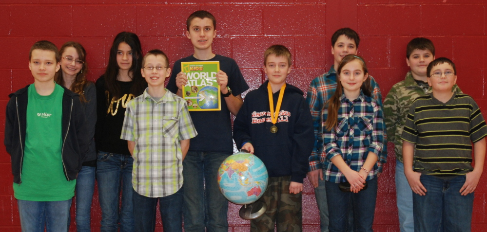 Participants in the Wells Junior High School 2014 Geography Bee included, front from left, Ben Campbell, Covy Dufort, Kate Pinette and Max Gates; and, back from left, Page Raymond, Paula Kaszynski, runner-up Matt Chase, winner Quentin Curtiss, Logan Worthley and Shawn Ouellette.