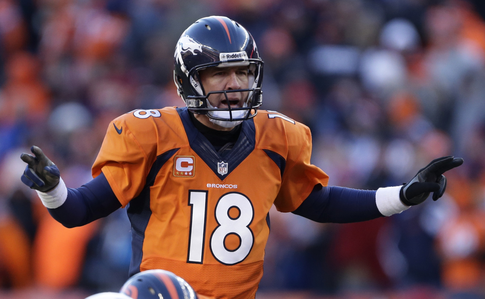 Denver Broncos quarterback Peyton Manning calls an audible at the line of scrimmage against the San Diego Chargers in the second quarter of an NFL divisional playoff football game in Denver.
