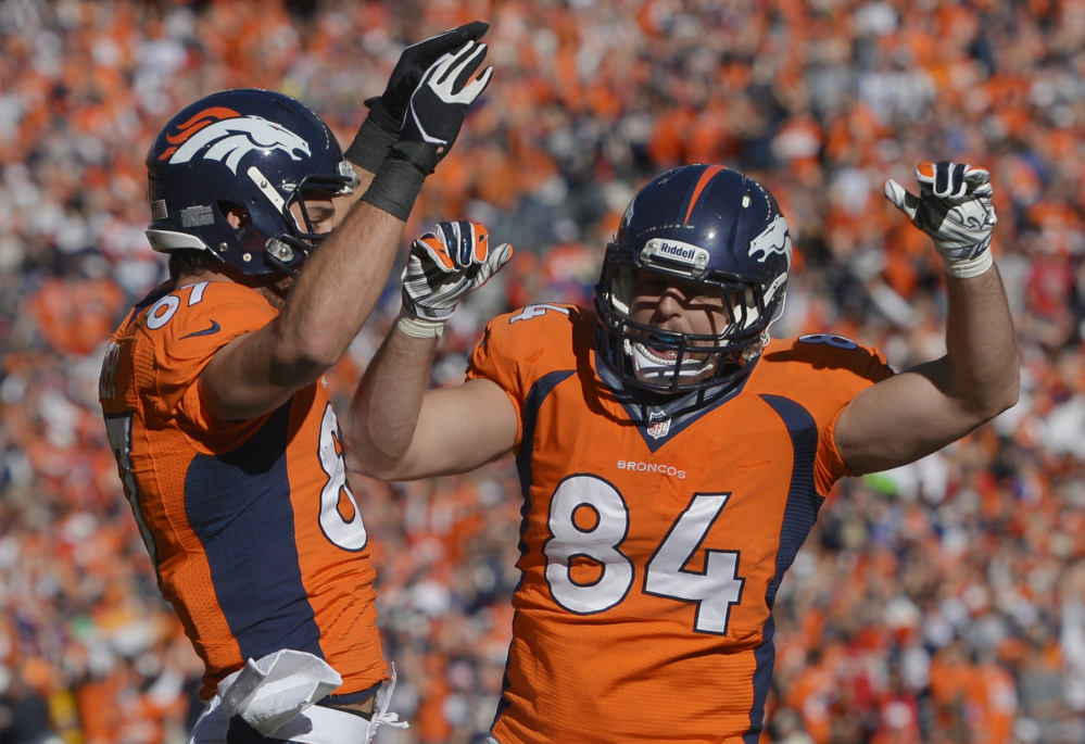 Broncos tight end Jacob Tamme celebrates his touchdown with Eric Decker in the first half of Sunday's AFC championship game against the New England Patriots at Denver.