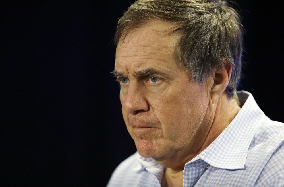 New England Patriots head coach Bill Belichick listens to a reporter's question during a news conference in Foxborough, Mass., on Monday, Jan. 20, 2014.