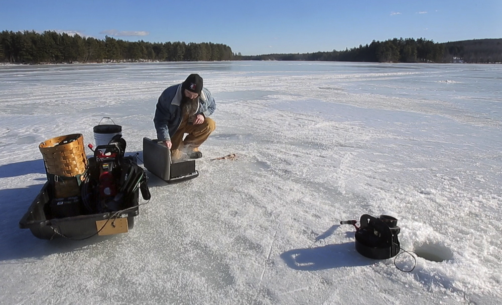 Josh Sparks of New Gloucester fries his fresh catch – a brook trout pulled from the chilly waters of Lower Range Pond in Poland – on his Coleman stove.