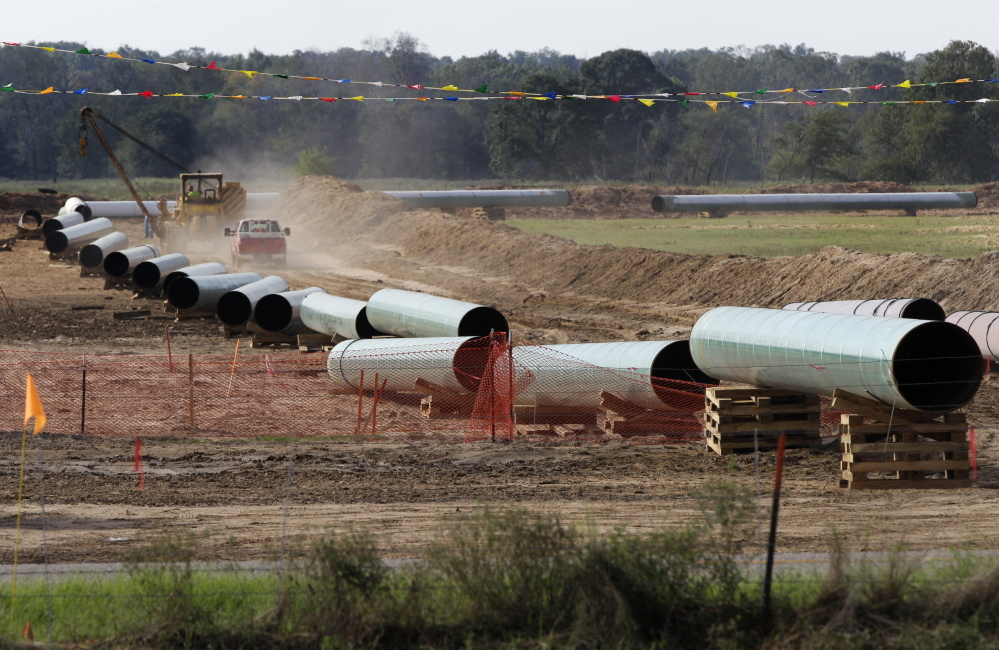 Sections of pipe are shown on a property next to Julia Trigg Crawford's farm, in Sumner, Texas. Crawford has been fighting the construction of the pipeline across her farm and argues that Calgary-based TransCanada did not have the right to take her land through eminent domain. Her case is currently in the Texas Supreme Court.