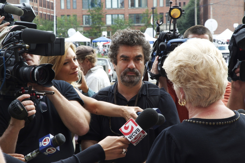 """Director Joe Berlinger, center, interviews Pat Donahue in the documentary film, """"Whitey: United States of America v. James J. Bulger."""" The film also includes interviews with prosecutors, defense attorneys and victims' relatives."""