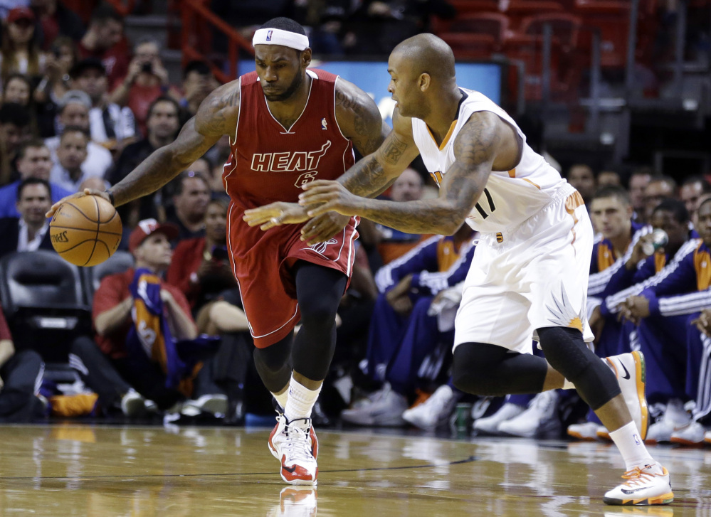 Miami Heat's LeBron James (6) is on a roster for the U.S. basketball team that includes the NBA's top 10 scorers.