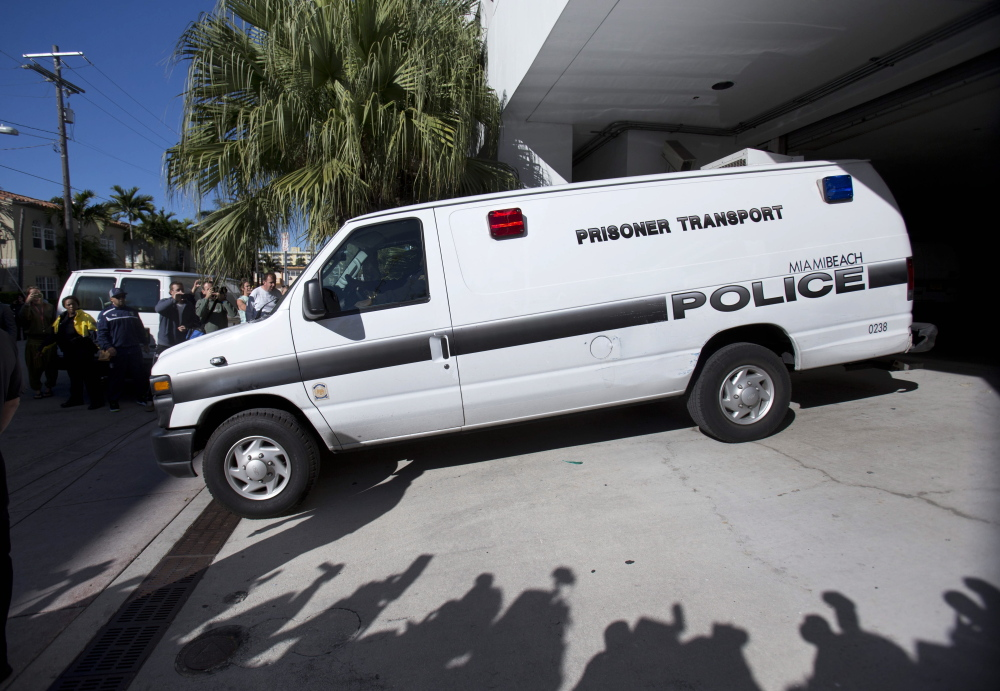 This prisoner transport van leaving the Miami Beach Police building Thursday morning was believed to be carrying pop singer Justin Bieber and R&B singer known as Khalil after their arrest.