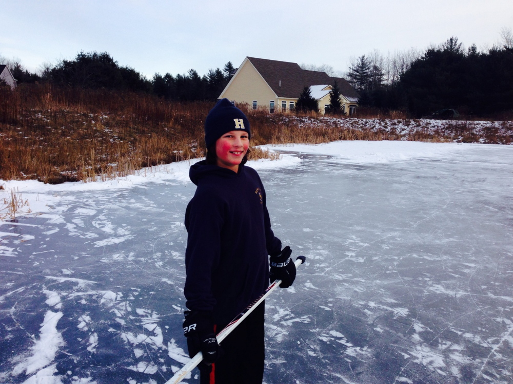 Matthew Cox, 10, plays hockey outside his home in Saco before Christmas. He suffered a brain injury Dec. 26 while visiting family in Massachusetts and died Friday at Boston Children's Hospital.