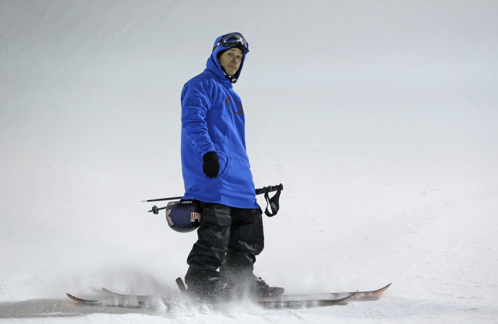 One day after an ACL injury ended Simon Dumont's chances of qualifying for the Olympics, the Bethel native was back on the mountain for the final skiing halfpipe qualifier last Saturday night in Park City, Utah.