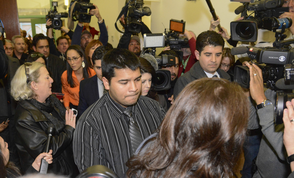 Erick Munoz, husband of Marlise Munoz, is escorted out of court by his attorney Heather L. King, right, on Friday in Fort Worth, Texas. The court ordered that Munoz's brain-dead pregnant wife be taken off life support.