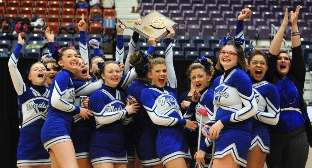 Staff photo by Joe Phelan Holding aloft their plaque, Madison cheerleaders celebrate winning the Class C West cheering championship on Saturday January 25, 2014 in the Augusta Civic Center.