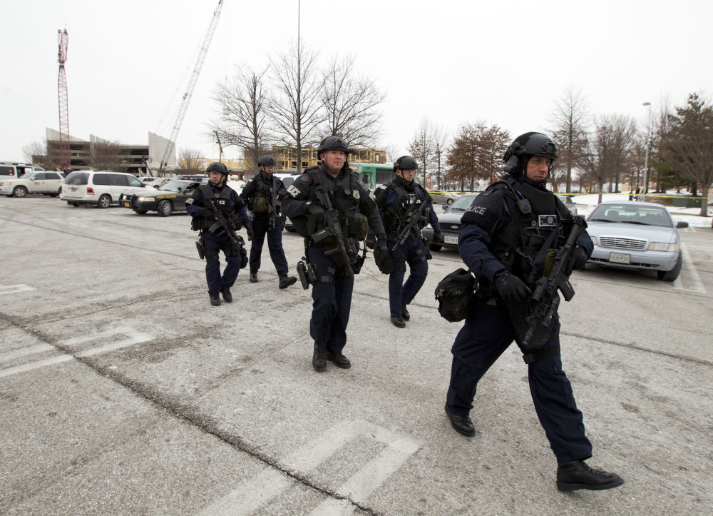 Police move in from a parking lot to the Mall in Columbia after reports of a multiple shooting on Saturday. Police in Maryland say three people died in a shooting at a mall in suburban Baltimore, including the presumed gunman.