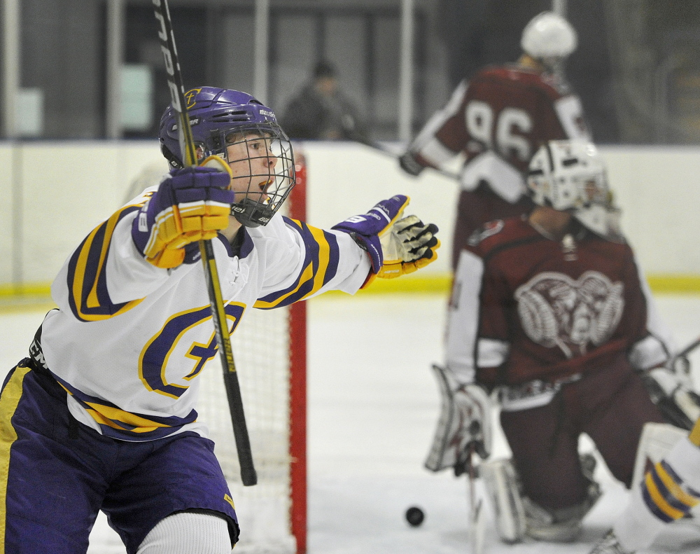 Keegan Thomas of Cheverus celebrates after scoring in the second period against Bangor. James Hannigan and James Kane also scored for the Stags.