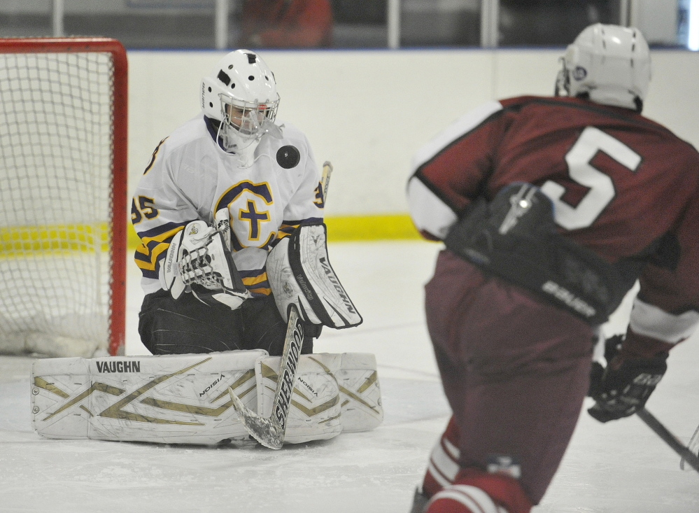 Cheverus goalie Jason Blier blocks a shot by Cam Dickson of Bangor during the third period of their schoolboy hockey game Saturday at Portland Ice Arena. Bangor scored the first three goals and held on for a 5-3 victory, improving its record to 7-1. Cheverus is 6-3-1.