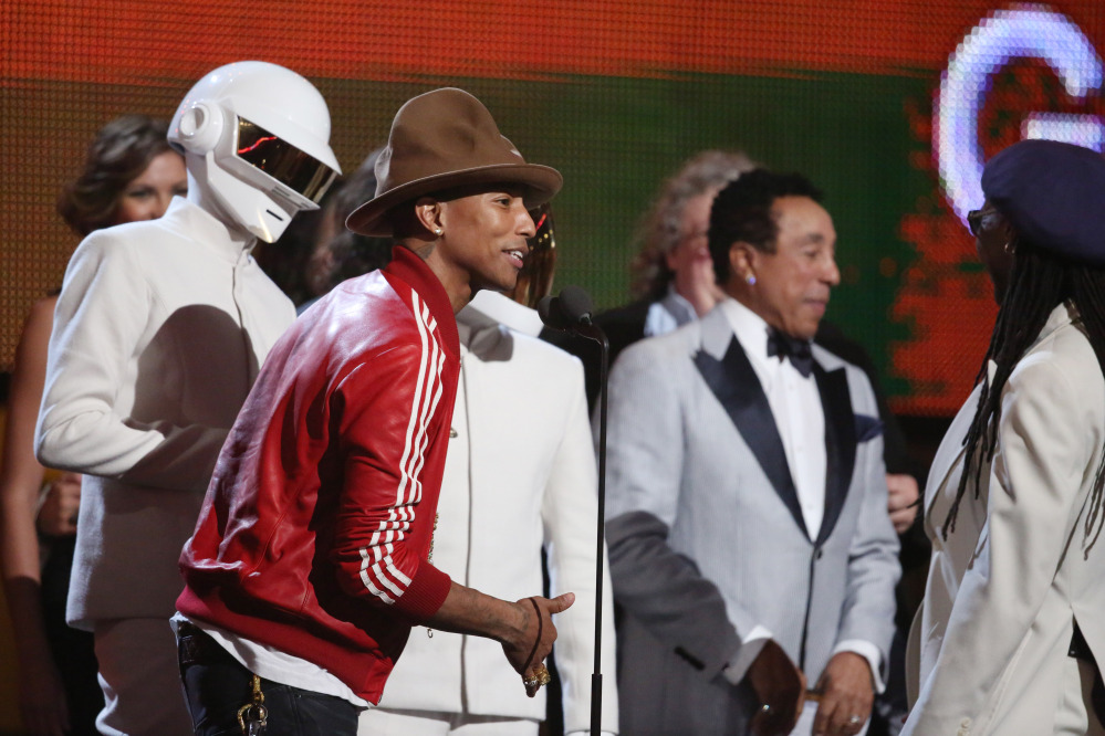 Pharrell Williams, second from left, and Daft Punk accept the award for Record of the Year.