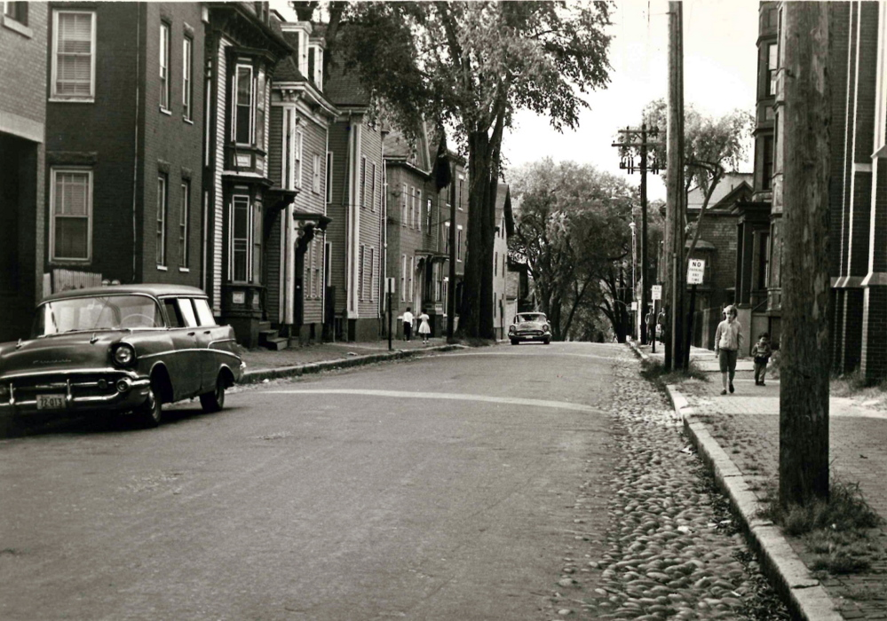 The Parish Hall of the Cathedral of the Immaculate Conception is visible along the right side of Franklin Street looking toward Back Cove in 1963, above, and today. The street is to be redesigned to make it more pedestrian-friendly, and a meeting this week will gather residents' input.