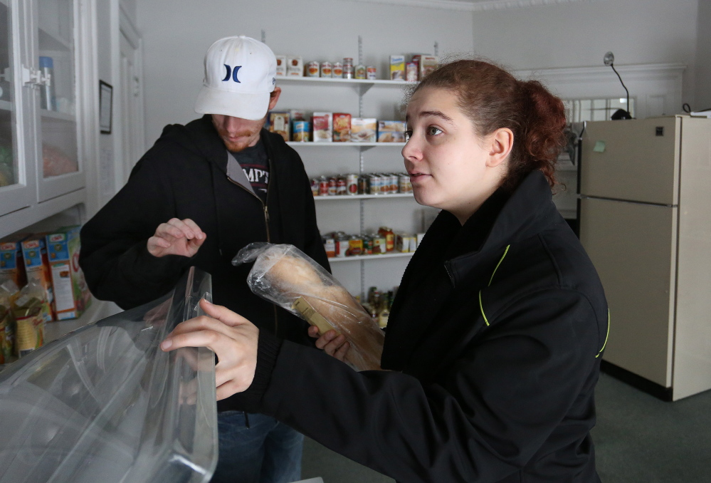"Jessie Santangelo and her roommate Joseph Carroll use the student food pantry at SMCC in South Portland for the first time. ""It's been really hard. Money is really tight,"" said Santangelo, 20, a second-year culinary arts student."