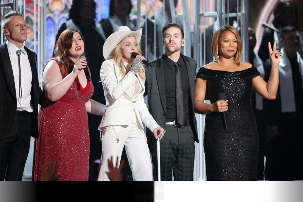 """Performers, from left, Macklemore, Mary Lambert, Madonna, Ryan Lewis and Queen Latifah appear on stage during a performance of """"Same Love"""" at the 56th annual Grammy Awards at Staples Center on Sunday in Los Angeles."""
