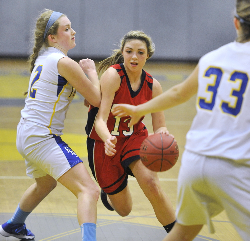 Alicia Dumont of Gray-New Gloucester drives to the basket past Falmouth's Emma Powers in Tuesday's girls' basketball game at Falmouth. The Yachtsmen won, 39-30.