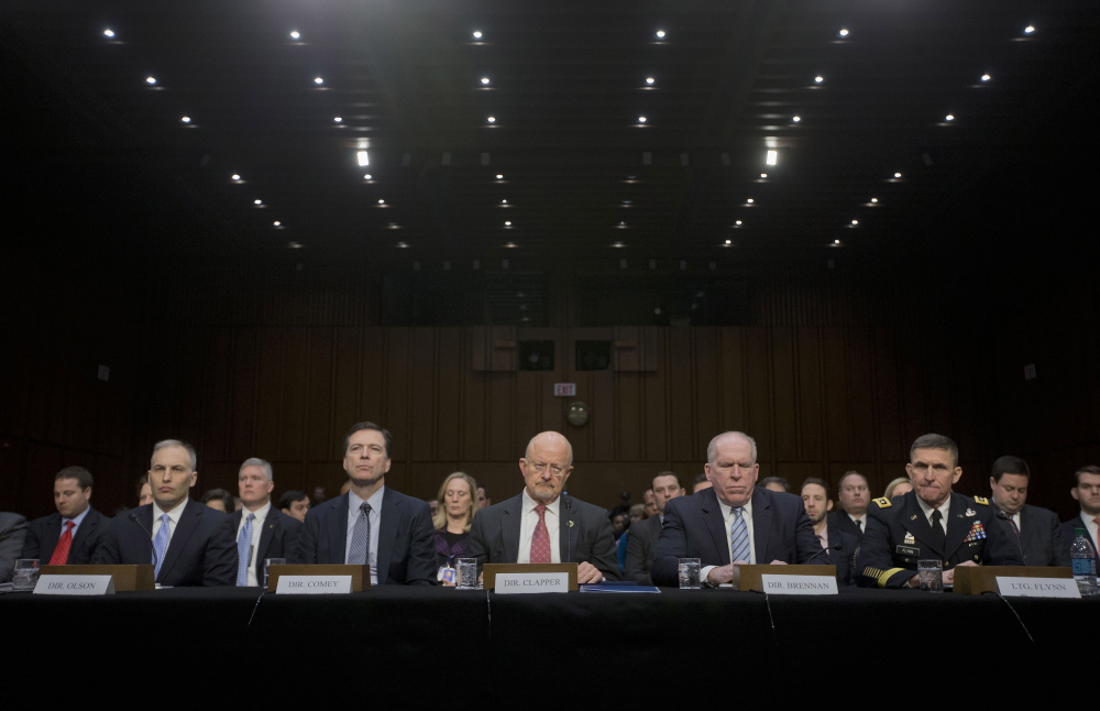 Director of National Intelligence James Clapper, center, and other security agency officials, testify on Wednesday before the Senate Intelligence Committe hearing on current and projected national security threats against the U.S. From left are, National Counterterrorism Center Director Matthew Olsen, FBI Director James Comey, CIA Director John Brennan, and Defense Intelligence Agency Director Lt. Gen. Michael Flynn.