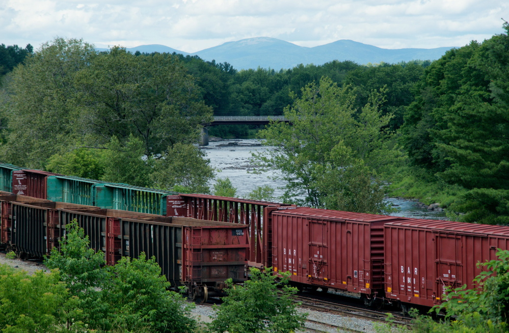 Box cars owned by the Montreal, Maine & Atlantic Railway sit idle in Brownville. The small bankrupt railway was sold at auction to a global firm that may like it, experts say, for its beeline between Montreal and Saint John, Canada.