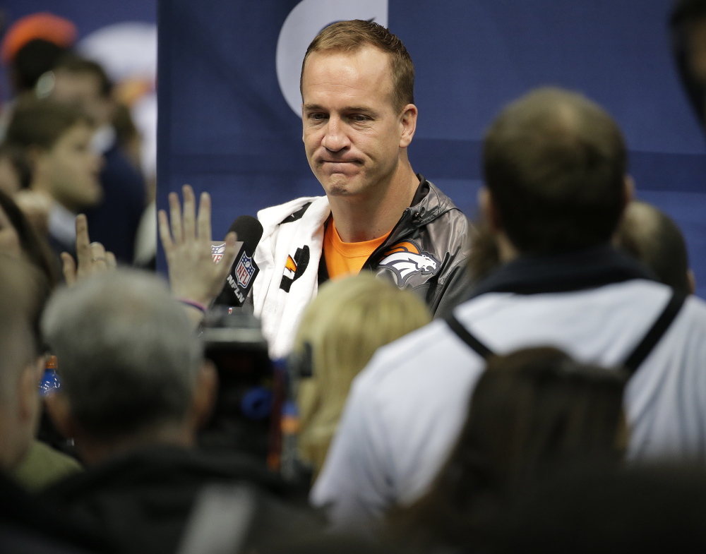 """Denver Broncos' Peyton Manning answers questions during media day for the NFL Super Bowl XLVIII football game on Tuesday in Newark, N.J. """"I've been being asked about my legacy since I was about 25 years old . . . I'm not even 100 percent sure what the word even means."""""""