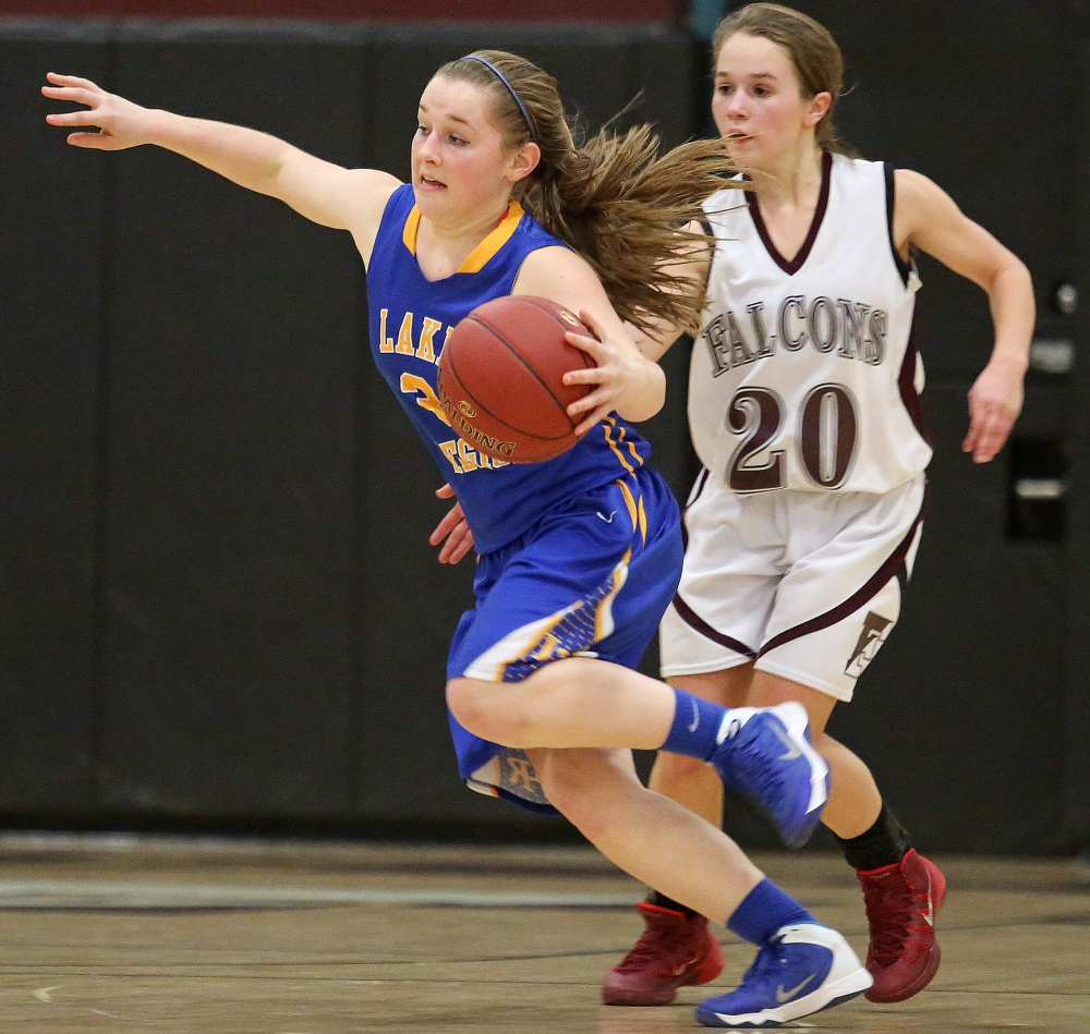 CeCe Hancock of Lake Region drives past Ashley Richardson of Freeport during Lake Region's 56-38 victory in a Western Maine Conference game Wednesday night.