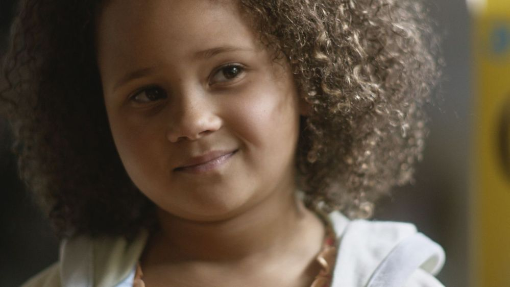 """This undated frame grab provided by General Mills shows the company's 2014 Super Bowl for Cheerios entitled """"Gracie."""" Cheerios brings back its famous interracial family in a spot that shows a father using Cheerios to tell his daughter she's going to have a brother. The ad airs during the first unscheduled time-out of the game."""
