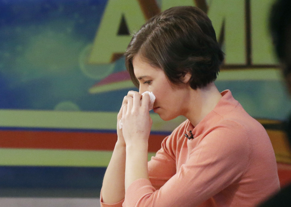 """Amanda Knox wipes her nose with a tissue while making an appearance Friday on ABC's """"Good Morning America."""""""