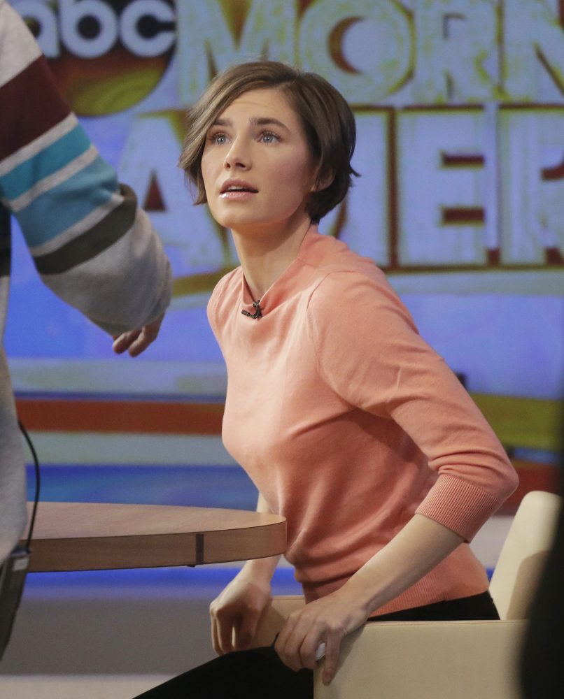 """Amanda Knox prepares to leave the set following a television interview with Robin Roberts on ABC's """"Good Morning America"""" Friday."""