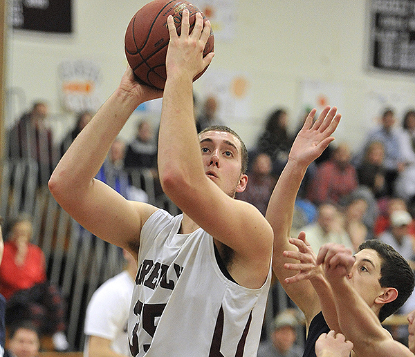 Greely center Michael McDevitt slips inside for a short jumper during Greely's 56-41 victory over York Friday night. The Rangers improved to 15-1.