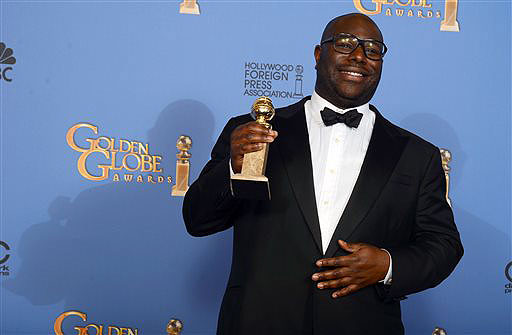 Steve McQueen poses in the press room with the award for best motion picture - drama for