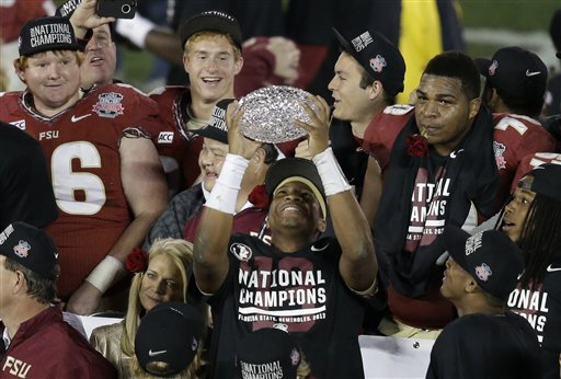 Florida State's Jameis Winston celebrates with The Coaches' Trophy after the NCAA BCS National Championship college football game against Auburn Monday in Pasadena, Calif. Florida State won 34-31.