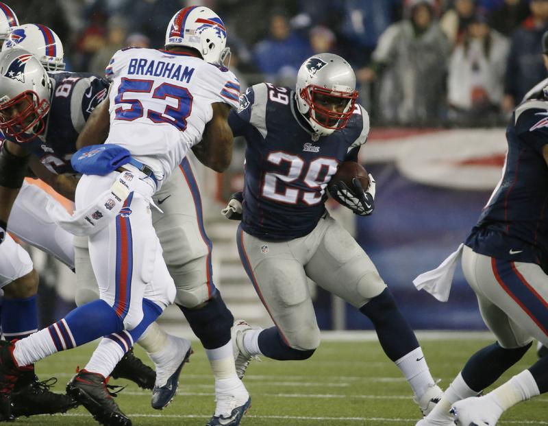 New England Patriots running back LeGarrette Blount (29) runs past Buffalo Bills linebacker Nigel Bradham (53) on Dec. 29 in Foxborough, Mass.