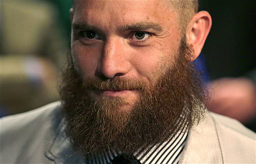 Boston Red Sox outfielder Jonny Gomes, the bandleader of the beard brigade during Boston's run to the 2013 World Series title, said he will be shaving his beard off before spring training.