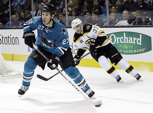 Sharks defenseman Scott Hannan is chased by the Bruins forward Patrice Bergeron in the second period of their game Saturday in San Jose, Calif.