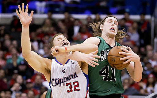 Los Angeles Clippers forward Blake Griffin, left, battles Boston Celtics center Kelly Olynyk for a loose ball during the first half in Los Angeles on Wednesday.