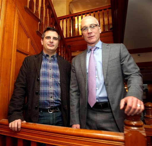 In this Jan. 13, 2014 photo, New Hampshire Republican Congressional candidate Dan Innis, right, poses with his partner Doug Palardy, in Portsmouth, N.H. The GOP's formal platform, as set in its 2012 national convention, declares that