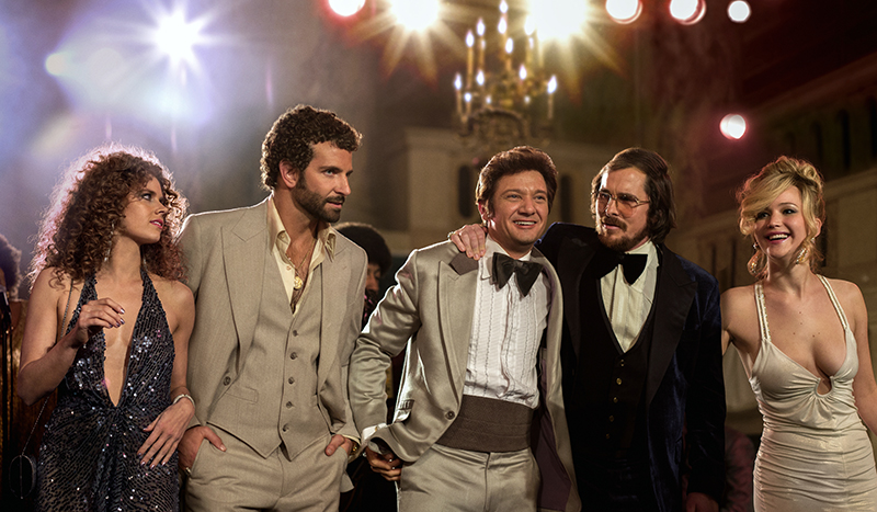 This film image released by Sony Pictures shows, from left, Amy Adams, Bradley Cooper, Jeremy Renner, Christian Bale and Jennifer Lawrence in a scene from
