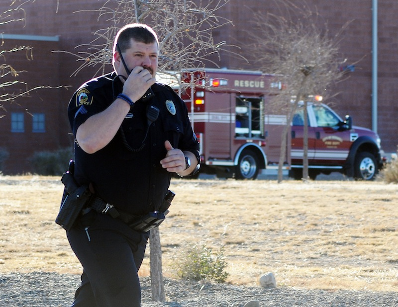 Law enforcement personnel set up a perimeter after a shooting at Berrendo Middle School, Tuesday, Jan. 14, 2014, in Roswell, N.M. A shooter opened fire at the middle school, injuring at least two students before being taken into custody.