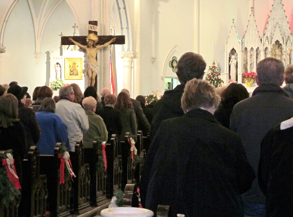 People fill Our Lady of Perpetual Help Church in Buffalo, N.Y. The attendance of a Mass mob rallied by social media is a financial help to some sparsely attended churches.