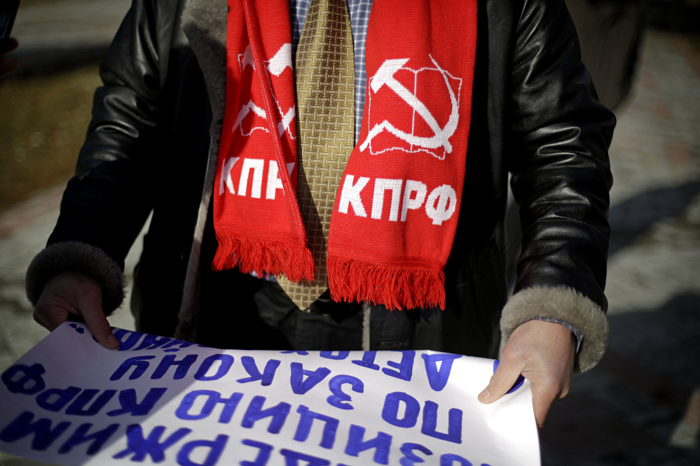 Igor Vasiliyev, head of the local branch of the Communist Party, wears a scarf decorated with a hammer and sickle, a symbol of the communist movement, as he leads a protest in the 50 Years of Victory in the Great Patriotic War Park to hold the first official demonstration in the designated Olympic protest area for the 2014 Winter Olympics on Saturday in Sochi, Russia. The protestors were members of the local branch of the Communist Party demonstrating for government benefits for Russian children of World War II born between 1928 and 1945.