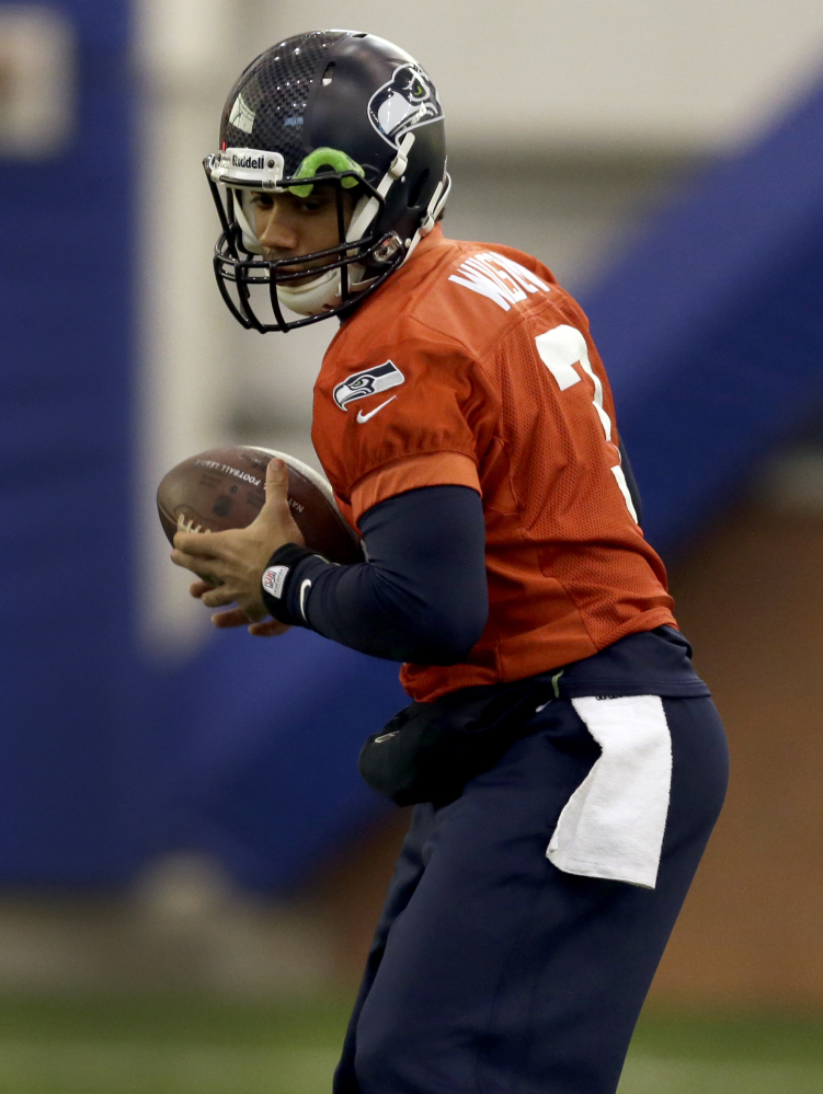 Russell Wilson of the Seattle Seahawks is one of the new breed of quarterbacks who can scramble out of the pocket and force defenses to adjust on the fly.