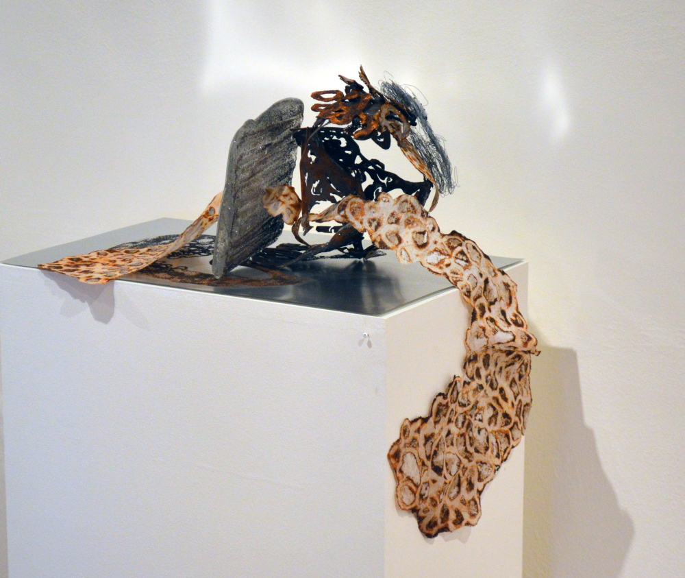 """""""Compression with Expansion 'A,'"""" cast glass, handmade paper, iron filings, pigment, steel, fabric, wire, magnets, iron and silkscreen."""