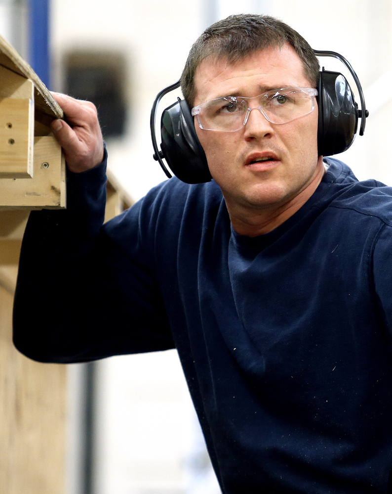 Travis Bentley participates in a building construction class at Central Maine Community College. He credits a special veterans court for his success.