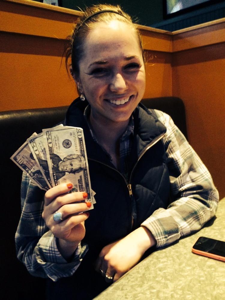 Sari Weiss, 21, of Portland holds her winnings from Binga's Stadium on Sunday.