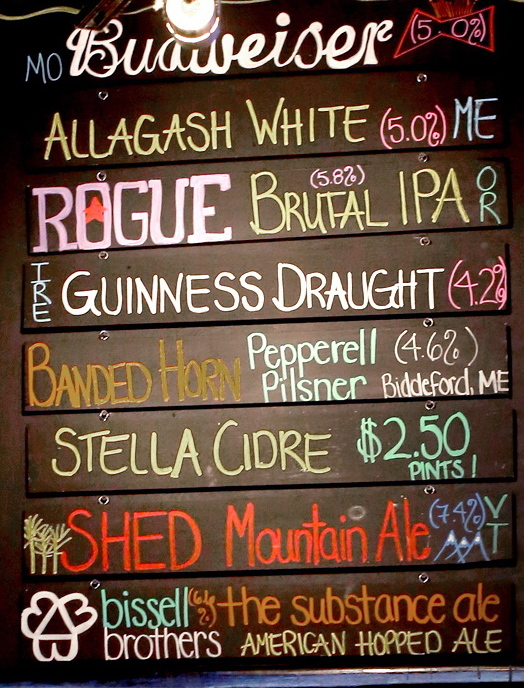 The alcohol content of some beers is posted on a sign inside Shay's Grill Pub in Portland.